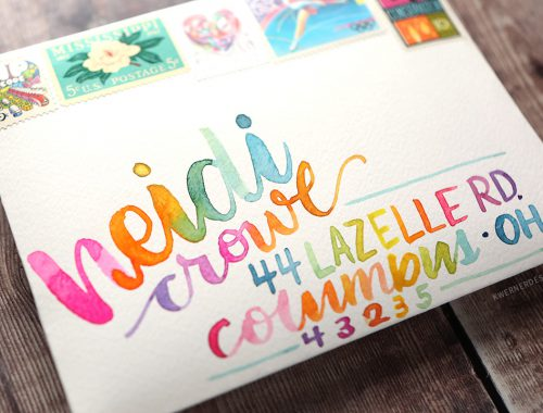 Addressing an envelope using watercolors and brush lettering.