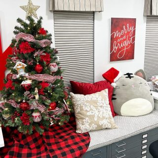 My craft room is ready for the 2021 Holiday Card Series! It starts this Monday, October 25!  The tree is up (don't look too closely—I still need to put some kitty pics in the frame ornaments), the Squishmallow cat is wearing a festive hat, the holiday pillows are out, and I hung up a lettering piece that I created and then had printed on a canvas. We're all set! Bring on the Christmas cards! #kwdesignhcs2021